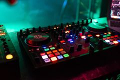 Professional mixer Board DJ for mixing and mixing club music at party with buttons and volume levels. Professional mixer Board DJ for mixing and mixing club Stock Image