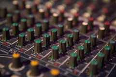 Professional mixing console for audio recording. Royalty Free Stock Image