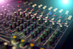 Professional mixing console for audio recording. Royalty Free Stock Photography