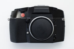 Professional 35mm film SLR camera body with red dot. Professional 35mm film SLR made in Portugal royalty free stock photography