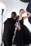 Professional model at work. Attractive female professional model at work, vertical Royalty Free Stock Photography