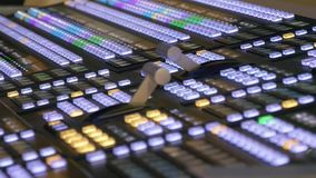 Professional modern broadcasting console. TV video and audio mixer stock footage