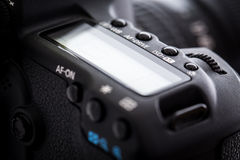 Professional modern DSLR camera - detail of the top LCD Royalty Free Stock Photos
