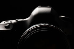 Professional modern DSLR camera low key image Stock Images