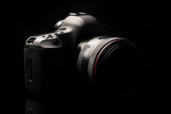 Professional modern DSLR camera low key image Stock Photos