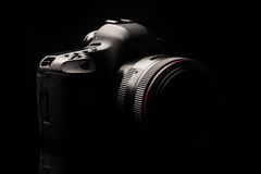 Professional modern DSLR camera low key image Royalty Free Stock Photo