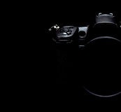 Professional modern DSLR camera low key stock photo/image Royalty Free Stock Photography