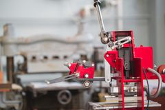 Professional modern printing press equipment in the typography. Close up royalty free stock photo
