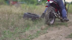 Professional motorcyclist drift and turns on a motorcycle on the ground, a biker does a trick on a motorcycle. Slow motion. In Odessa stock video footage
