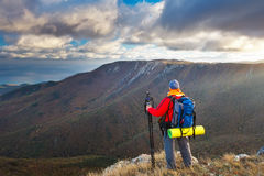 Professional on mountain. Nature photographer takes photos Stock Photography