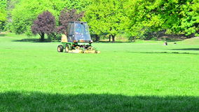 Professional mower or lawn and garden tractor in a park in Dresden, Germany stock footage