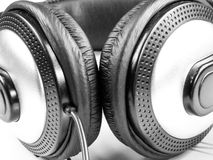 Mucic headphones close up black and white. Professional mucic headphones and wire close up Royalty Free Stock Images