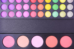 Professional multi colored blushes and eyeshadows palettes stock image
