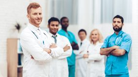 Professional Multinational Doctors Camera Posing. royalty free stock images