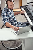 Professional musician adding sound effects Royalty Free Stock Images