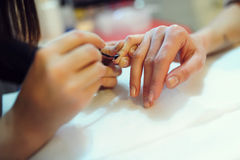 Professional Nail Care. A shot from a photo session taken in a Beauty Salon Stock Photos