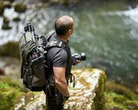 Nature photographer outdoor. Professional nature photographer with backpack and tripod outdoor Stock Images