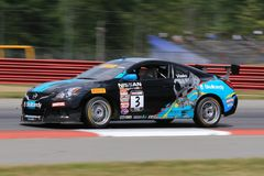 Professional Nissan Altima race car on the track Stock Images