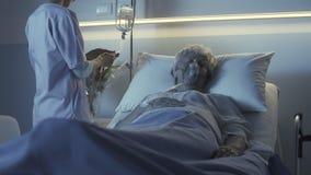 Professional nurse checking a senior patient at night