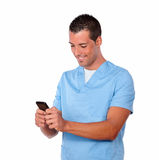 Professional nurse guy texting with his cell Royalty Free Stock Photo