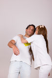 Professional nurse holding sick fainting man Royalty Free Stock Image