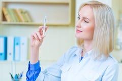 Professional nurse making injection Stock Image