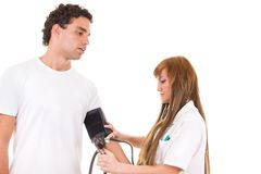 Professional nurse measures the blood pressure of a patient Royalty Free Stock Photo