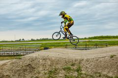 Professional off-road bicyclist jumping on bicycle stock image