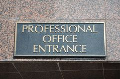 Professional office entrance. Attached on the wall Stock Photo