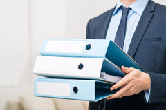 Professional office worker holding folders Royalty Free Stock Photo
