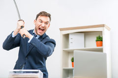 Professional office worker holding sword Stock Photos