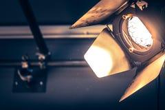 Professional orange studio spotlight in a TV studio. Professional orange studio spotlight hanging on the ceiling stage equipment event show theatre beam lighting stock photos