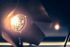 Professional orange studio spotlight in a TV studio. Professional orange studio spotlight hanging on the ceiling stage equipment event show theatre beam lighting stock photo