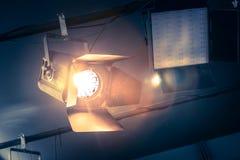 Professional orange studio spotlight in a TV studio. Professional orange studio spotlight hanging on the ceiling stage equipment event show theatre beam lighting stock image