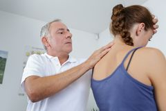 Professional osteopathy therapy treatment on neck female patient royalty free stock photo