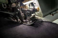 Professional overlock sewing machine with black fabric. Overlock sewing machine with black fabric Royalty Free Stock Photo