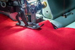 Professional overlock sewing machine with red fabric Stock Image