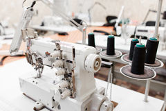 Professional overlock sewing machine in workshop Royalty Free Stock Photography