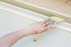 Professional Painter Cutting In With Brush to Paint Garage Door Royalty Free Stock Photo
