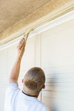 Professional Painter Cutting In With Brush to Paint Garage Door Royalty Free Stock Photography