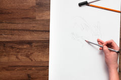 Professional painter draw hands with pensil Stock Photo