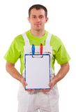 Professional painter holding empty clipboard with  Stock Images