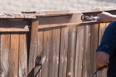 Professional Painter Spraying Yard Fence with Stain Royalty Free Stock Photo