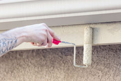 Professional Painter Using Small Roller to Paint House Fascia Royalty Free Stock Photography