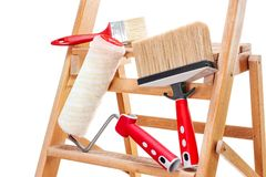 Professional painter, work tools. Work tools for professional house painter on a wooden ladder, isolated on white background stock photos