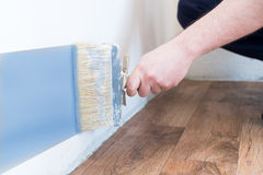 Professional painter worker is painting one wall Royalty Free Stock Photos