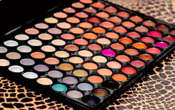 Professional palette of colored eyeshadows, close-up. Royalty Free Stock Photo
