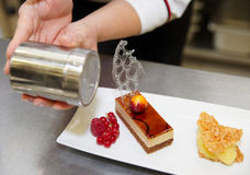 Professional pastry chef is decorating a dessert Royalty Free Stock Photo