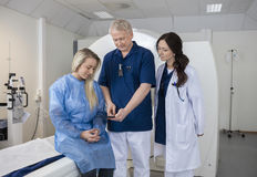 Professional With Patient And Doctor Using Computer Before MRI S Stock Images