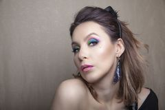 Professional peacock make-up and hairstyle on beautiful woman face - studio beauty shot stock photos